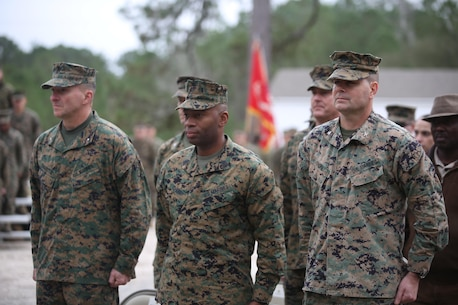 Senior leadership from 2nd Marine Logistics Group stand at attention at the start of the ribbon cutting ceremony, unveiling a newly renovated training facility, at Camp Lejeune, N.C., Jan. 6, 2016. The site is to be used for future Corporals Courses and by 2d MLG Marines and sailors. (U.S. Marine Corps photo by Lance Cpl. Miranda Faughn/Released)