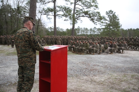 U.S. Navy Capt. Bill Muhm, 2nd Marine Logistics Group chaplain leads the Marines and sailors in prayer during the ribbon cutting ceremony to unveil the newly renovated 2nd MLG Corporals Course facility at Camp Lejeune, N.C., Jan. 6, 2016. The buildings on the site of the new Corporals Course were to be demolished, but were saved for their potential use as a training facility.  (U.S. Marine Corps photo by Lance Cpl. Miranda Faughn/Released)