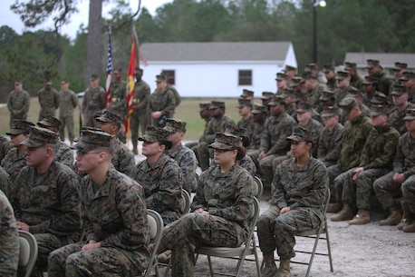 Officers and enlisted Marines and sailors from 2nd Marine Logistics Group gathered to unveil the new Corporals Course training center, now open for use at Camp Lejeune, N.C., Jan. 6, 2016. Brig. Gen. Charles Chiarotti, the commanding general for 2nd Marine Logistics Group spoke with them about the importance of non-commissioned officers and training at all stages of their careers. (U.S. Marine Corps photo by Lance Cpl. Miranda Faughn/Released)