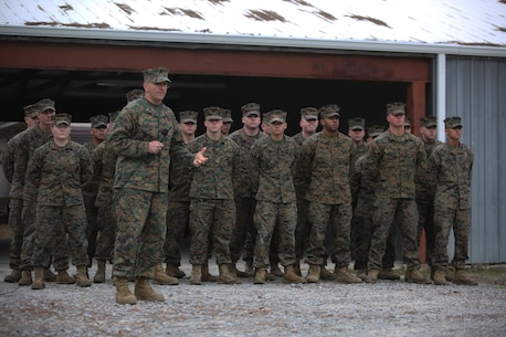 Brig. Gen. Charles Chiarotti, commanding general for 2nd Marine Logistics group, recognizes the group of Marines who helped rebuild the unit's new Corporals Course facility, during its unveiling at Camp Lejeune, N.C., Jan. 6, 2016. The buildings on the site were supposed to be demolished, but were renovated for their potential to be used as a training facility. (U.S. Marine Corps photo by Lance Cpl. Miranda Faughn/Released)
