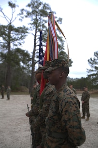 The color guard prepares to present the colors to begin the ribbon cutting ceremony to unveil 2d Marine Logistics Groups new traning facility for corporals course at Camp Lejeune, N.C., Jan. 6, 2016. Marines from various MLG units gathered to witness the reveal of the renvated space. (U.S. Marine Corps photo by Lance Cpl. Miranda Faughn/released)