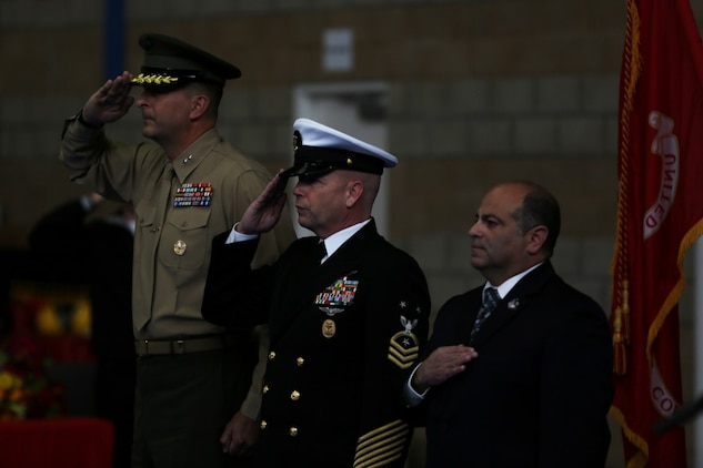 Master Chief Petty Officer Robert Lemons (center), the command master chief of the 1st Marine Division, salutes alongside Maj. Gen. Daniel O'Donohue (left), commanding general of the 1st Mar. Div., during Lemons' retirement ceremony aboard Marine Corps Base Camp Pendleton, Calif., Jan. 8, 2016. Lemons enlisted in the U.S. Navy in 1986 and served a majority of his time in the service as a corpsman.