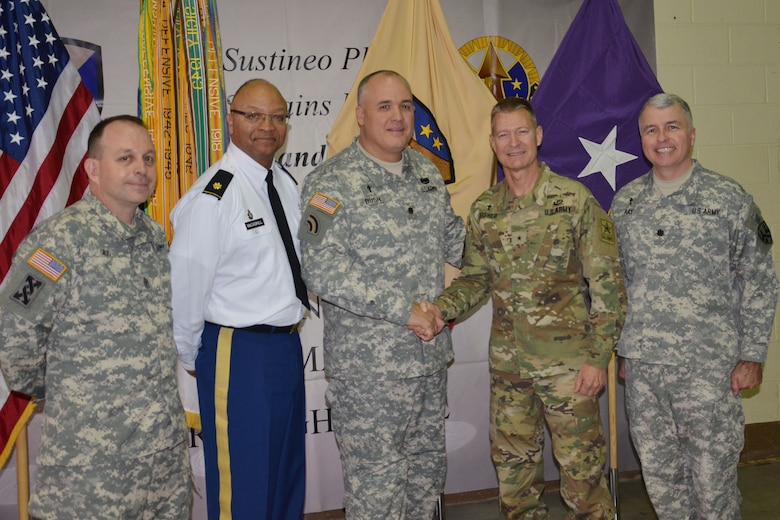 Chaplain (Brig. Gen.) Carlton Fisher, assistant chief of chaplains for mobilization and readiness in the Office of the Chief of Chaplains (OCCH) at the Pentagon, congratulates Chaplain (Lt. Col.) Jeffery Bush, command chaplain of the Army Reserve Sustainment Command of Birmingham during Bush's promotion ceremony. Also pictured from left to right: Sgt. Maj. Ward Gros, chaplain assistant with the 377th Theater Sustainment Command, Chaplain (Maj.) Henry McCaskill Jr., command chaplain of the Deployment Support Command, Chaplain (Lt. Col.) Jeffery Bush, command chaplain of the Army Reserve Sustainment Command, Chaplain (Brig. Gen.) Carlton Fisher, assistant chief of chaplains for mobilization and readiness in the Office of the Chief of Chaplains (OCCH) at the Pentagon, and Chaplain (Lt. Col.) Brian Ray, command chaplain for the 377th Theater Sustainment Command of New Orleans, Louisiana.
