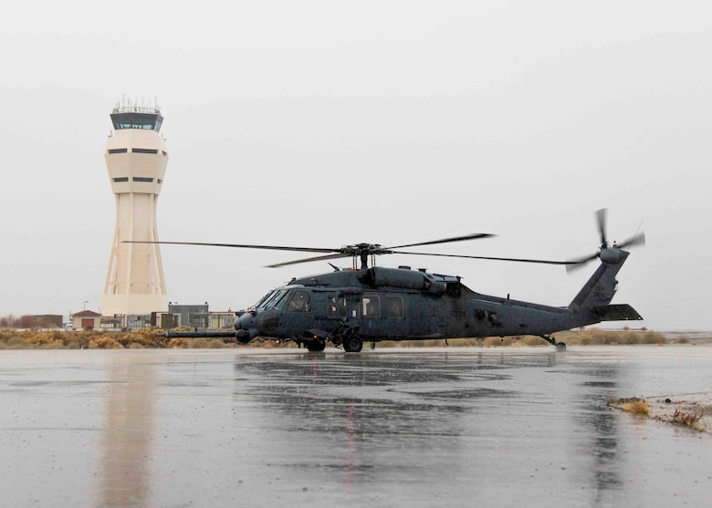 A HH-60G Pave Hawk from Nellis Air Force Base, Nev., will be at Edwards AFB, Calif., until Jan. 22, 2016, where the 412th Test Wing and 418th Flight Test Squadron are providing facilities, range safety, photographic documentation and maintenance support equipment for testing of the GAU-21 .50-caliber machine gun. Edwards AFB's Gun Harmonizing Range will be used primarily for the testing. (U.S. Air Force photo/Christopher Okula)