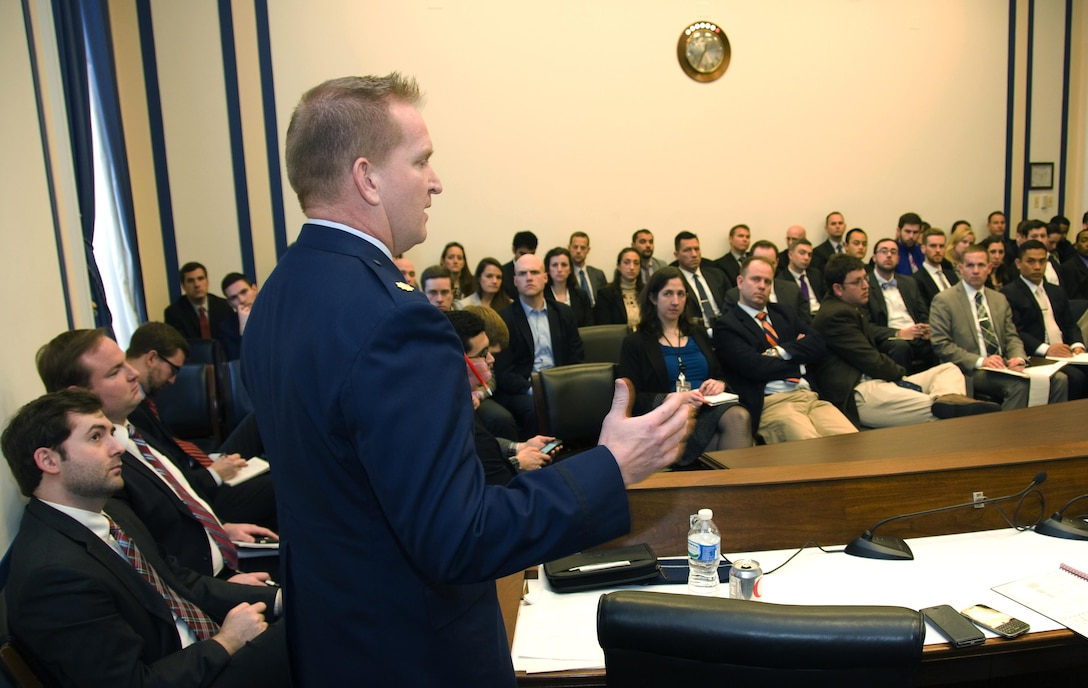 Maj. Nathan Perry, the chief of airborne capabilities for Air Staff 10 that handles the Air Force's nuclear mission, discusses nuclear operations with policymakers during an Air Force 101 session at the Rayburn House Office Building in Washington, D.C., Jan. 11, 2015. The bi-monthly sessions educate policymakers on Air Force matters to help them make informed decisions. (U.S. Air Force photo/Sean Kimmons)