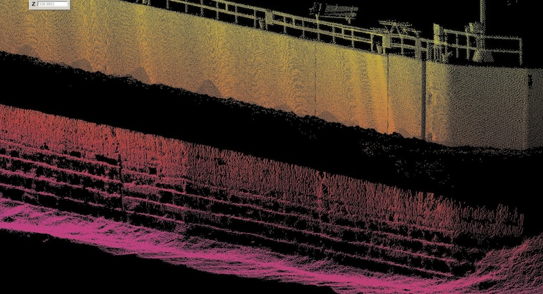 A multibeam sonar was used initially to inspect the underwater wooden cribbing that supports the concrete guidewall at Locks and Dam 15. The cribbing, shown here near the bottom of the image as alternating black and colored stripes, did not appear to be damaged and therefore a dive team was called in for further investigation.
