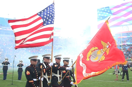 The Color Guard of Recruiting Station Jacksonville presents the American Flag during the National Anthem before the beginning of the TaxSlayer Bowl January 2nd, 2016, in Jacksonville, Fla. (Official Marine Corps photo by Cpl. John-Paul Imbody)