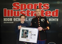 Hannah DeBalsi, Athlete of the Month from Staples High School, is presented with a plaque by Staff Sergeant Jason Caldwell on behalf of the U.S. Marine Corps and Sports Illustrated,  Jan. 9, 2016 at Staples High School, Westport, Conn. DeBalsi received the award for excellence in cross-country, her desire to give back to her community and her superior performance in her academics.
