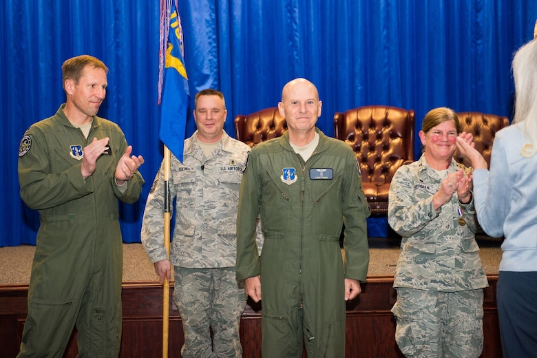 U.S. Air Force Col. Louis Perino, center, the commander of the 116th Medical Group, Georgia Air National Guard, stands at attention while Col. Mark Weber, the commander of the 116th Air Control Wing, left and Col. Muriel Herman, former commander of the 116th Medical Group, applaud after Perino took command of the 116th Medical Group during a ceremony at Robins Air Force Base, Ga., Jan. 10, 2016. A board certified emergency medicine physician, Perino replaced Herman who commanded the group for more than six years. Perino is also the Chief of Aerospace Medicine and the Deputy State Air Surgeon for the Georgia Air National Guard and brings 23 years of Air National Guard and a wealth of civilian experience to the position. (U.S. Air National Guard photo by Senior Master Sgt. Roger Parsons)