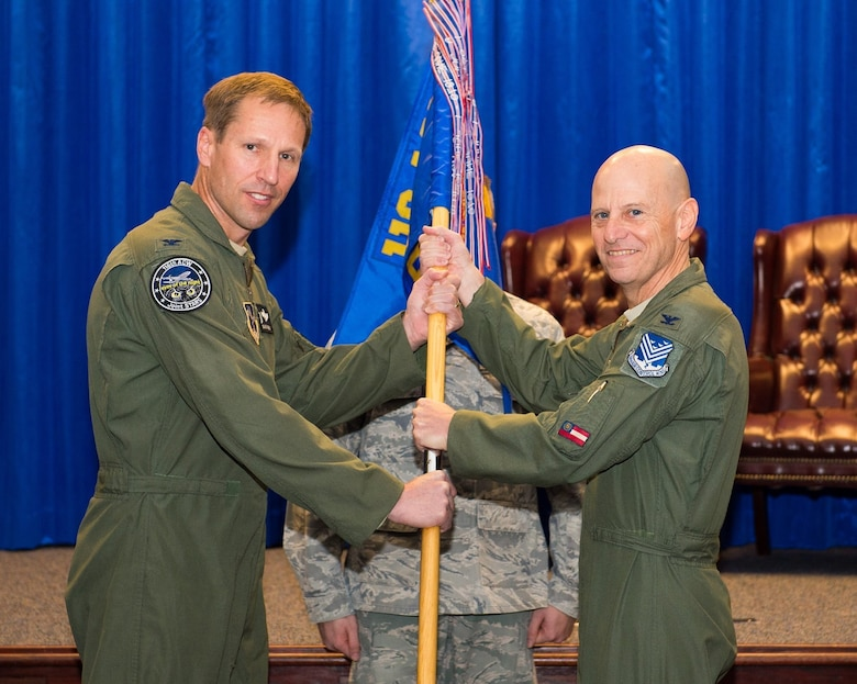 U.S. Air Force Col. Louis Perino, right, the commander of the 116th Medical Group, Georgia Air National Guard, receives the unit guidon from Col. Mark Weber, the commander of the 116th Air Control Wing, during a change of command ceremony at Robins Air Force Base, Ga., Jan. 10, 2016. A board certified emergency medicine physician, Perino replaced Col. Muriel Herman who commanded the group for more than six years. Perino is also the Chief of Aerospace Medicine and the Deputy State Air Surgeon for the Georgia Air National Guard and brings 23 years of Air National Guard and a wealth of civilian experience to the position. (U.S. Air National Guard photo by Senior Master Sgt. Roger Parsons)