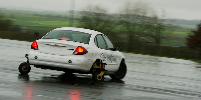 U.S. Air Force Tech. Sgt. Gregory Westmoreland, a 52nd Fighter Wing Safety occupational safety and health technician, spins out while driving a vehicle during a training session at the Saber Driving Course at Spangdahlem Air Base, Germany, Jan. 8, 2016. The 52nd Fighter Wing Safety team purposefully designed the course conditions so trainees would spin out and lose control of the vehicle to build reflexive skills and knowledge for real-world situations of the same nature. (U.S. Air Force photo by Staff Sgt. Christopher Ruano/Released)