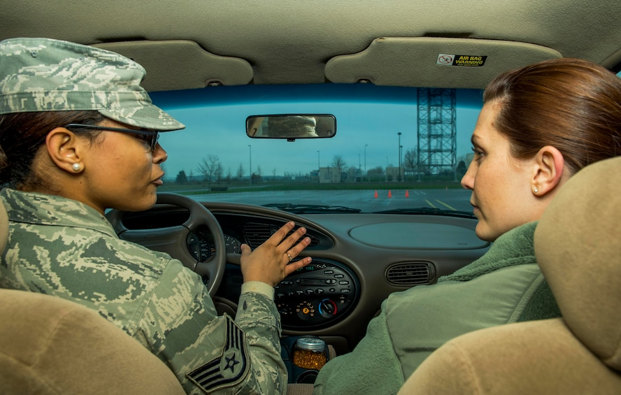 U.S. Air Force Staff Sgt. Brittany McGill, left, instructs U.S. Air Force Staff Sgt. Jessica Morgan, both 52nd Fighter Wing Safety occupational safety and health technicians, during a training session at the Saber Driving Course at Spangdahlem Air Base, Germany, Jan. 8, 2016. New technicians and points-of-contact must undergo the Saber Driving Course training program to better instruct Airmen during the actual training class. (U.S. Air Force photo by Airman 1st Class Timothy Kim/Released)