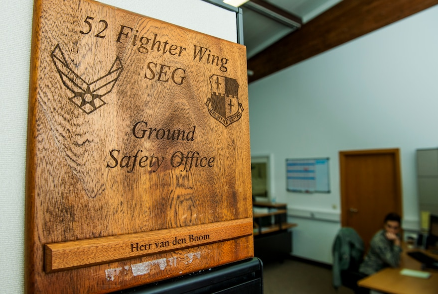 The 52nd Fighter Wing Ground Safety Office sign is displayed in their building before a training session at Spangdahlem Air Base, Germany, Jan. 8, 2016. The office runs the Saber Driving Course program, which trains Airmen how to operate vehicles during dangerous road conditions. (U.S. Air Force photo by Airman 1st Class Timothy Kim/Released)