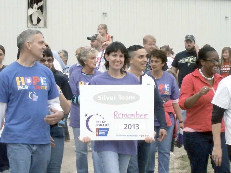 Shawn and Dee Wolfe, co-captains of Team REMEMBER, a Relay for Life team organized by AEDC employees, make laps around the track at the Coffee County Fairgrounds as part of the Relay for Life event. (Courtesy photo)