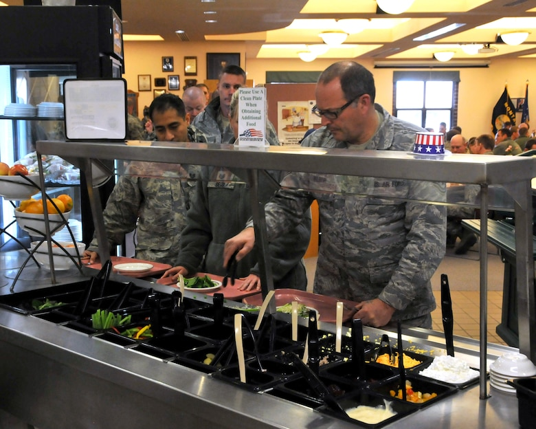 "Master Sgt. Winston Wilbur prepares a salad during the unit's regularly scheduled drill weekend Nov. 8, 2015. The ""green"" foods identified by the G4G Program are nutrient dense and lower in calories than ""yellow"" or ""red"" foods. (U.S. Air National Guard photo by Tech. Sgt. Michael Touchette/Released)"