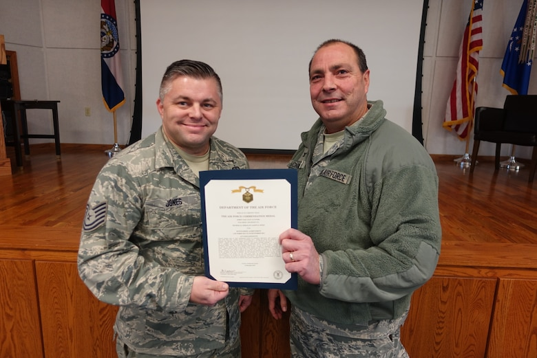 Tech. Sgt. Jason D. Jones receives the Air Force Commendation Medal by Col. Ralph Schwader at Rosecrans Air National Guard Base in St. joseph, Mo., on Jan. 10, 2016.  (U.S. Air National Guard photo by Tech. Sgt. Michael Crane).