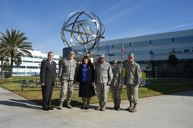 The Honorable Suzanne Fuentes (center), Mayor of El Segundo, Calif., stands for a group photo with the Space and Missile Systems Center and 61st Air Base Group leadership in front of the Armillary Sphere -- aka the Space Motif -- a landmark within SMC's Schriever Space Complex at Los Angeles Air Force Base. The mayor is joined by (left to right) Tom Fitzgerald, acting SMC executive director, Maj. Gen. Robert McMurry, SMC vice commander, Lt. Gen. Samuel Greaves, SMC commander and Air Force program executive officer for space, Col. Donna Turner, 61st ABG commander and Chief Master Sgt. Craig Hall, SMC command chief. The mayor's visit Dec. 21, 2015 included an office call and SMC briefing. The Air Force and the city have a long-standing relationship of cooperation as Los Angeles AFB and SMC reside within the city limits of El Segundo. The meeting was an opportunity to strengthen that relationship and discuss emerging issues. (U. S. Air Force photo/Joseph Juarez, Sr.)