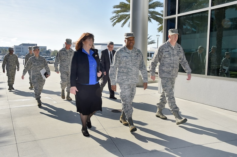 The Honorable Suzanne Fuentes, Mayor of El Segundo, Calif., is escorted by Lt. Gen. Samuel Greaves, Space and Missile Systems Center commander and Air Force program executive officer for space and Maj. Gen. Robert McMurry, SMC vice commander, during the mayor's visit to Los Angeles Air Force Base Dec. 21, 2015 for an office call and SMC briefing. Col. Donna Turner, 61st Air Base Group commander, Chief Master Sgt. Craig Hall, SMC command chief and Tom Fitzgerald, acting SMC executive director, follow in attendance. (U. S. Air Force photo/Joseph Juarez, Sr.)