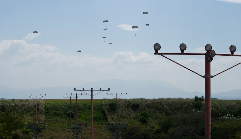 U.S. Army Soldiers with the Special Operations Command South (Forward) 7310 and Honduran soldiers with the 2nd Honduran Airborne Brigade complete a static-line training jump Jan. 11, 2016 at Soto Cano Air Base, Honduras to remain current on their jump requirements. The Soldiers from the two countries often train together to share best practices and form interpersonal bonds. (U.S. Air Force photo by Capt. Christopher Mesnard/Released)
