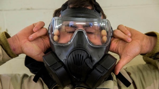 A Marine with 2nd Marine Logistics Group breaks the seal on his mask after entering the gas chamber at Marine Corps Base Camp Lejeune, N.C., Jan. 8, 2016. Marines, while exposed to chlorobenzylidene malononitrile, or CS gas, must conduct a series of exercises before breaking the seal on their mask followed by properly don and clearing it. The chamber is a routine exercise to ensure the durability of each Marines gear while exposed to chlorobenzylidene malononitrile, or CS gas, which is a bi-annual qualification requirement for Marines.