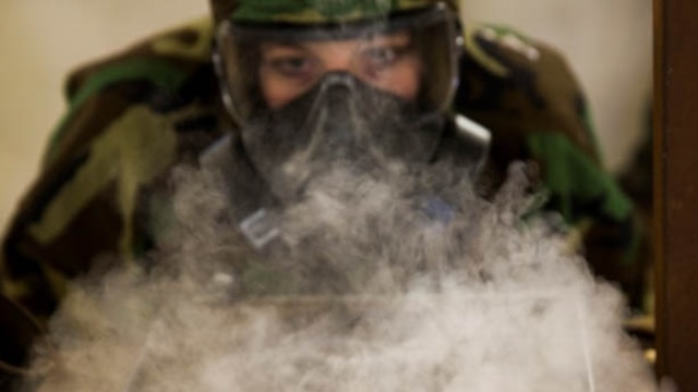 Lance Cpl. Jamie Roper, a chemical, biological, radiological, and nuclear Marine with Headquarters Company, 2nd Marine Logistics Group, disperses chlorobenzylidene malononitrile, or CS gas, in preparation for gas chamber bi-annual qualification at Marine Corps Base Camp Lejeune, N.C., Jan. 8, 2016.  The chamber is a routine exercise to ensure the durability of each Marines gear while exposed to CS gas.
