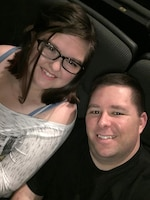 Kate Gatewood, 19, and her father, Air Force Master Sgt. Bryan Gatewood, pose for a selfie Dec. 31, 2015, at the Johnson IMAX Theater in the National Museum of Natural History in Washington D.C. Kate Gatewood, who was treated for leukemia when she was 13, was declared cancer-free by her doctors in December 2015.