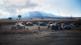 COMBINED ARMS TRAINING CENTER, GOTEMBA, Japan — Marines' tents stand in below Mt. Fuji during Exercise Fuji Samurai at Combined Arms Training Center Camp Fuji, Gotemba, Japan, Jan. 7, 2016. Exercise Fuji Samurai is held at CATC Fuji during the month of January and includes countless fire and maneuver drills and other combat-based training evolutions that take place over a period of approximately two weeks. During this time, Marines must face the chill and challenge of Mt. Fuji, as they spend night after night subject to the winter elements. The tents provided Marines with shelter from the unforgiving Mt. Fuji chill as they rested between training events.