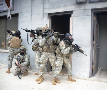 New York Army National Guard Soldiers assigned to Company A, 1st Battalion 69th Infantry, prepare to conduct room-clearing training at the New York Police Department's urban training facility at Rodman's Neck in The Bronx, on Jan. 9, 2016.