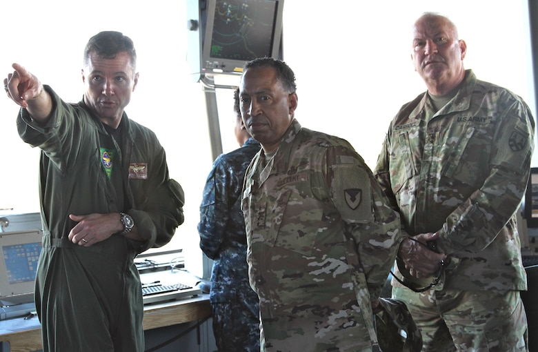 The Commander of the 377th Theater Sustainment Command, Maj. Gen. Les Carroll (right), hosted the Commander of the U.S. Army Materiel Command, Gen. Dennis Via (center) during a command visit to Naval Air Station Joint Reserve Base New Orleans Jan. 8. During the visit, Gen. Via received a base overview by NAS JRB Commander, Navy Capt. Mark Sucato (left). The 377th TSC serves as the largest two-star command in the Army Reserve with a mission to operate as the Senior Army Logistics headquarters capable of planning, controlling and synchronizing operational-level Army deployment and sustainment.