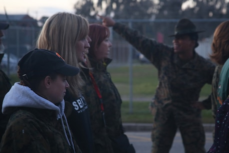 Educators from the greater Fort Lauderdale, Fla. area stand in formation as a Marine drill instructor barks commands at them aboard Marine Corps Recruit Depot Parris Island, S.C., January 13, 2016. The three-day workshop will give the educators a chance to experience the day-to-day routines aboard the depot and Marine Corps Air Station Beaufort, S.C. The purpose of the workshop is to give the educators a better understanding of the Marine Corps. (Official Marine Corps photo by Cpl. John-Paul Imbody)