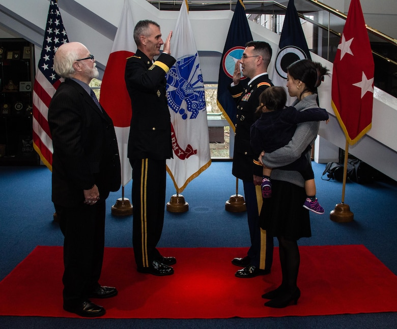 Army Maj. Gen. James F. Pasquarette (left), commanding general, U.S. Army Japan, conducts the Oath of Commissioned Officers to newly promoted Army 2nd Lt. Riki R. Riordan (right), signal officer, 311th Signal Command, during a direct commission ceremony held Jan. 6, 2016, in Camp Zama, Japan. The ceremony was one of the first of its kind to take place within U.S. Army Japan as Riordan, a former sergeant first class in the Army Reserve and current Department of Army civilian working at USARJ's G3 (plans/operation) section, earned his rank without having first graduated from a U.S. military academy, Officer Candidate School or Reserve Officer Training Corps program. Direct commissions are typically only offered to enlisted Soldiers seeking a commission in the Army Reserve. Born and raised in Tokyo, Riordan enlisted in the Army in 2001 and served as a cavalry scout. Riordan transitioned to the Army Reserve in 2003 and continued to serve his country as a drill sergeant and, later, as a Contingency Acquisition Support Model subject matter expert for U.S. Army Japan. (U.S. Army photo by Army Sgt. John L. Carkeet IV, U.S. Army Japan)