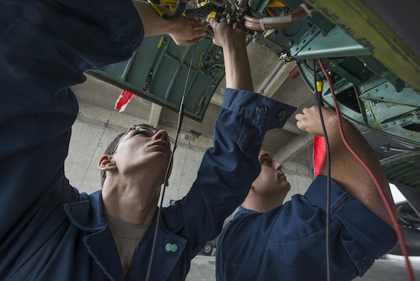 Airman 1st Class Sean Greig and Senior Airman Caleb Stephens, both 67th Aircraft Maintenance Unit avionics specialists, test F-15 Eagle components during maintenance Jan. 8, 2016, at Kadena Air Base, Japan. The two specialists were troubleshooting a problem with the aircraft that limited its ability to measure and display the distance to the airfield. (U.S. Air Force photo/Staff Sgt. Maeson L. Elleman)