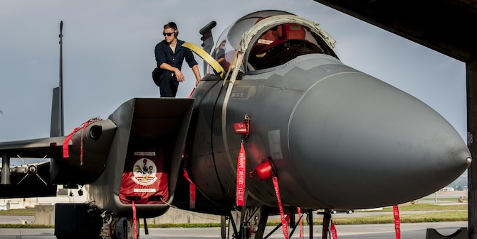 Airman 1st Class Justin Wanke, a 67th Air Maintenance Unit electricity and environmental specialist, helps conduct a cabin pressure test on an F-15E Strike Eagle, Jan. 8, 2016, on the flightline at Kadena Air Base, Japan. Cabin pressure tests are conducted to prevent hypoxia, a lack of oxygen reaching muscle tissue, from occurring in pilots. (U.S. Air Force photo/Airman 1st Class Nick Emerick)