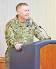 Col. Patrick D. Frank, 1st Infantry Division deputy commanding officer for support, delivers the opening remarks at the Army Family Action Plan Conference Nov. 17 at Riley's Conference Center.