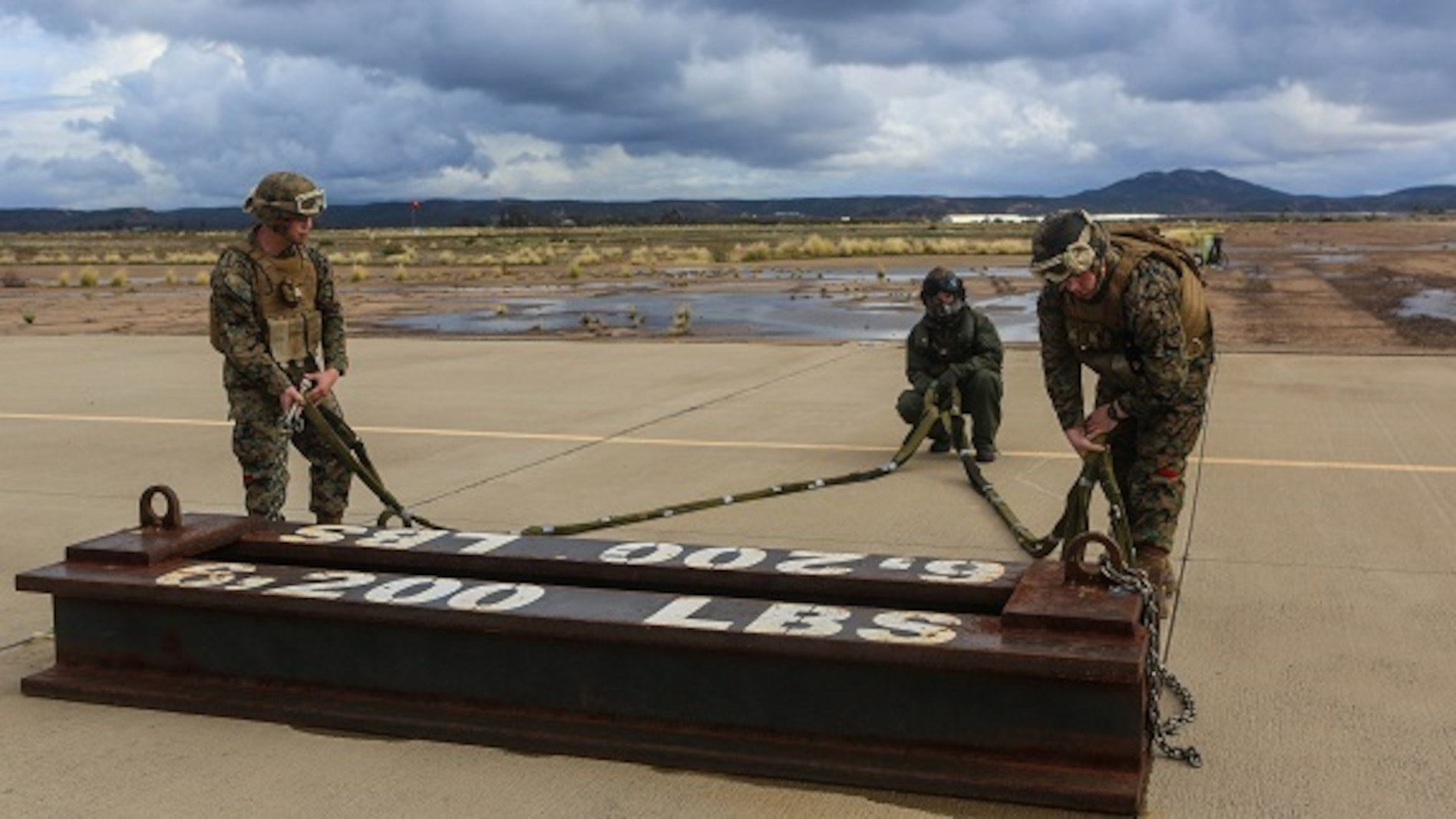 Marines with Combat Logistic Battalion (CLB) 11 prepare a 6,200 pound steel beam for a CH-53E Super Stallion lift aboard Marine Corps Air Station Miramar, Calif., Jan. 7. Marines with Marine Heavy Helicopter Squadron (HMH) 465 and CLB-11 practiced daytime external lift training to prepare for deployments. (U.S. Marine Corps photo by Lance Cpl. Harley Robinson/Released)