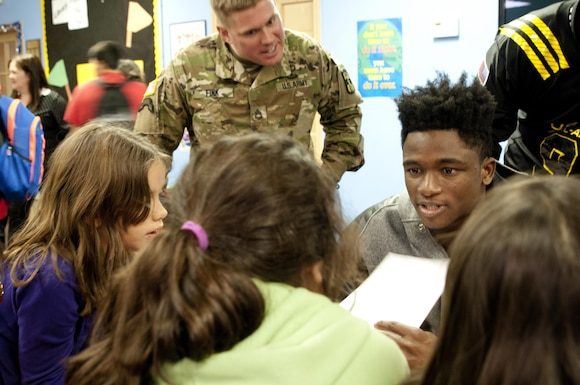 Team East defensive back Trayvon Mullen (right), Coconut Creek High School in Coconut Creek, Fla., and Sgt. 1st Class Andrew Fink, the 2016 Army Noncommissioned Officer of the Year, try to stump the students during a math game Tuesday, Jan. 5 at Boysville in San Antonio, Texas. Soldiers and the nation's top high school football players are visiting locations like Boysville, a program for children from abused and neglected homes, as part a way to give back to the community leading up to the 2016 Army All-American Bowl, which takes place Saturday, Jan. 9 at the Alamo Bowl in downtown San Antonio. (U.S. Army photo by Sgt. Brandon Hubbard, 204th Public Affairs Detachment/Released)