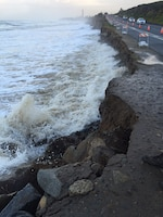 Winter storms and high tide combine their energy to force water up against the Pacific Coast Highway, in Carlsbad. The Corps of Engineers authorized the emergency placement of protective stone to prevent further damage.