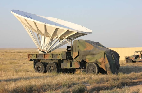 A 5-ton vehicle carrying a 30-foot radar dish stands ready at Saylor Creek Range Complex, Idaho. Contract range personnel modified the vehicle to create a target capable of being relocated for different mission needs. (Courtesy photo)