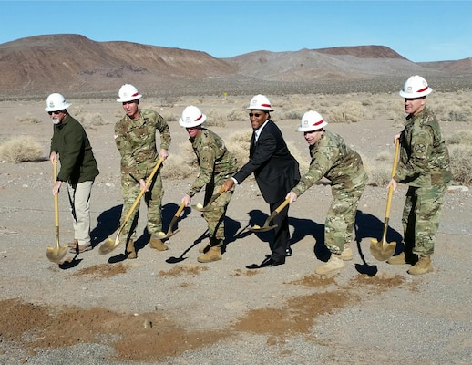 Officials toss ceremonial shovels of dirt for the new MQ-1C Gray Eagle UAS facility during a groundbreaking ceremony Jan. 12 at Fort Irwin, California. Pictured from left to right are: Todd Gillum, Cox Construction; Maj. Gen. Joseph Martin, commanding general, National Training Center and Fort Irwin; Col. Kirk Gibbs, commander, U.S. Army Corps of Engineers Los Angeles District; Marcus Watkins, director, NASA Management Office; Col. Matthew Ruedi, commander, 916th Support Brigade and Col. G. Scott Taylor, commander, U.S. Army Garrison Fort Irwin.