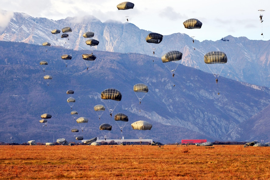 U.S. Army paratroopers descend to the ground after exiting a C-130 Hercules aircraft over the Juliet drop zone in Pordenone, Italy, Jan. 8, 2016. The paratroopers are assigned to the 173rd Brigade Support Battalion. U.S. Army photo by Massimo Bovo
