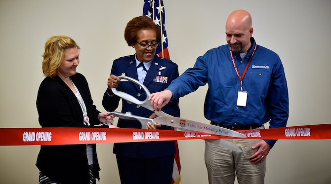 Col. Vanessa Mattox, 932nd Medical Group commander, is joined by Lacie Ebers from Kirlin Builders and Barry Klassy, executive vice president of Kroeschell Engineering, during a ribbon-cutting ceremony that was held Jan. 11, 2016, at the 932nd Aerospace Medicine Squadron's clinic. The new facility is located on the fourth floor of the hospital at Scott Air Force Base, Illinois. (U.S. Air Force photo by Christopher Parr)