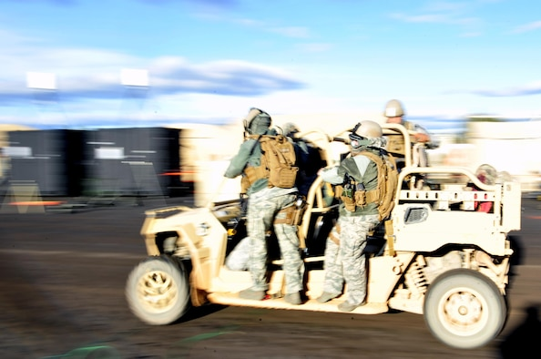 Members of the 1st Special Operations Security Forces Squadron transport a simulated casualty during exercise Frigid Archer 2016 at Eglin Range, Fla., Jan. 10, 2016. Frigid Archer tested 1st Special Operations Wing Air Commandos' expertise through a myriad of operational and support requirements. (U.S. Air Force photo by Staff Sgt. Tyler Placie)