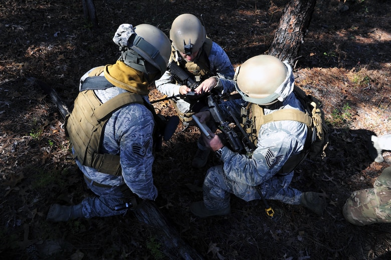 Members of the 1st Special Operations Security Forces Squadron plan dismounted-patrol operations during exercise Frigid Archer 2016 at Eglin Range, Fla., Jan. 10, 2016. Frigid Archer tested 1st Special Operations Wing Air Commandos' expertise through a myriad of operational and support requirements. (U.S. Air Force photo by Staff Sgt. Tyler Placie)