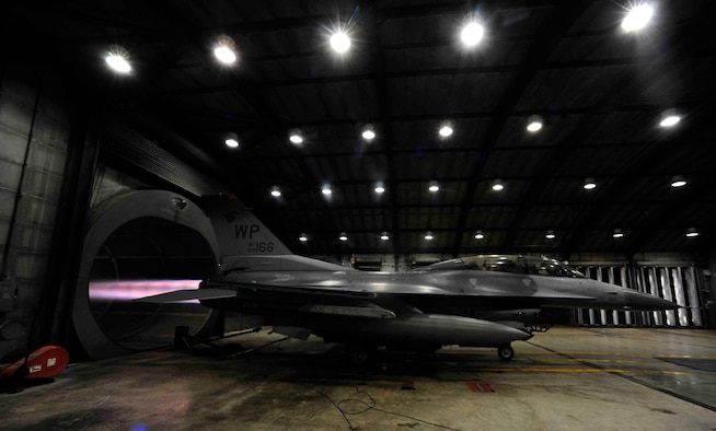The afterburner of an F-16 Fighting Falcon is run during a hush house engine test at Kunsan Air Base, Republic of Korea, Dec. 9, 2015. The hush house is an engine test facility that is similar to a sound booth in a musical production studio. It keeps all of the sound inside of the facility to prevent any noise from being heard outside.  (U.S. Air Force photo by Staff Sgt. Nick Wilson/Released)