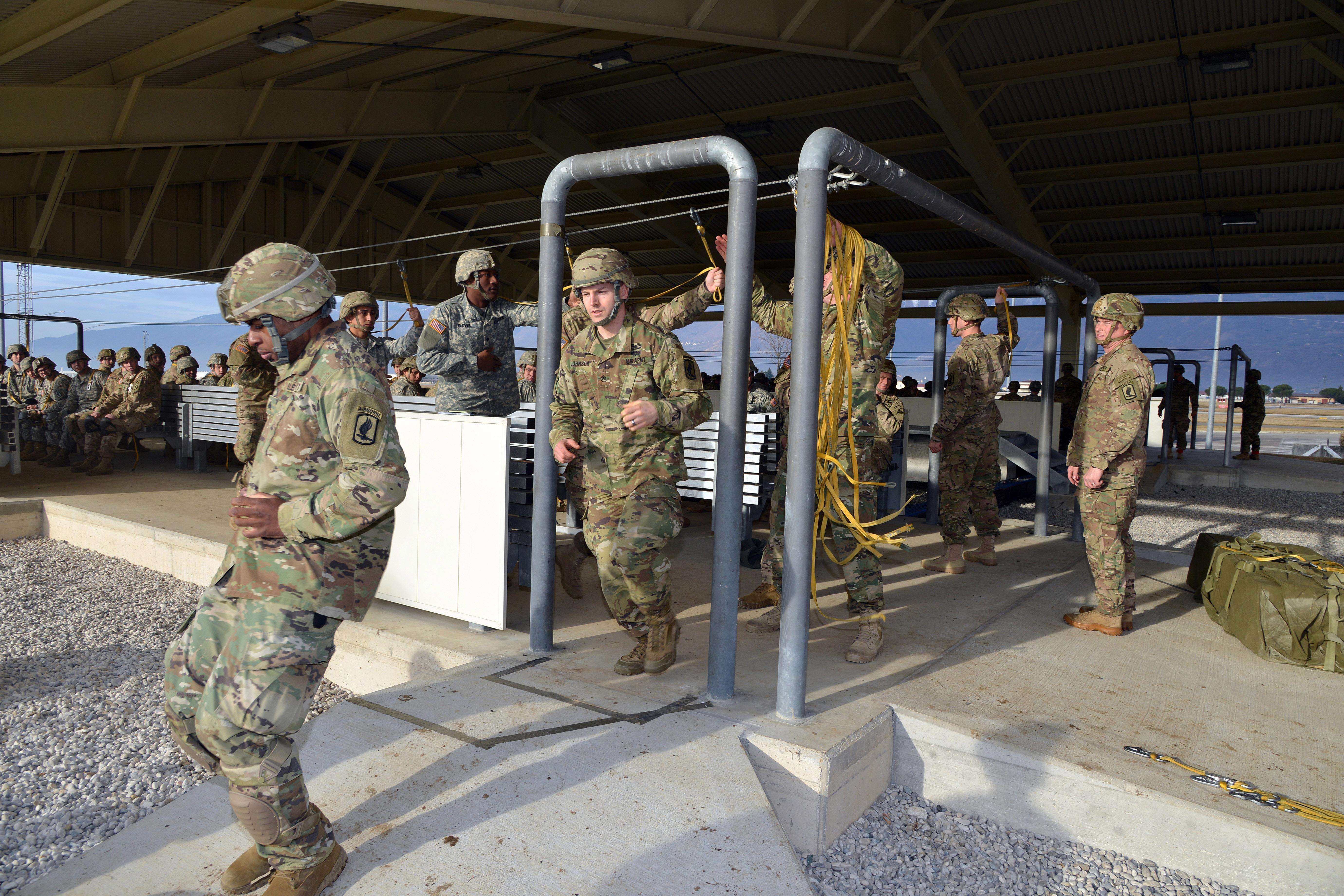U.S. paratroopers practice door exits on the mock door trainer at Aviano Air Base Italy & U.S. DEPARTMENT OF DEFENSE \u003e Photos \u003e Photo Gallery