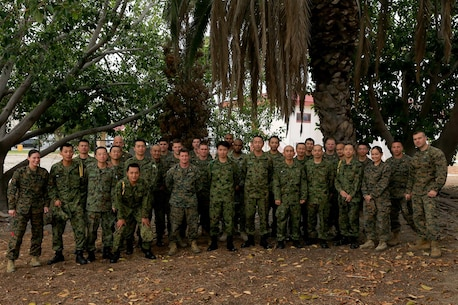 U.S. Marines and Japan Ground Self Defense Force (JGSDF) soldiers pause for a group photo at the end of their final planning conference for Exercise Iron Fist 2016. Exercise Iron Fist is an annual bilateral amphibious training exercise between the USMC and JGSDF designed to enhance our ability to plan, communicate and conduct amphibious operations. The 11th MEU and JGSDF will conduct the exercise from late January to early March 2016.