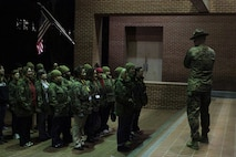 Educators from both Recruiting Stations Orlando and Fort Lauderdale stand in formation as the drill instructors give them a small brief about a portion of the recruit training aboard Marine Corps Recruit Depot Parris Island, S. C., January 13, 2016. The three-day workshop will give the educators a chance to experience the day to day routines aboard the depot and Marine Corps Air Station Beaufort, with the main purpose of giving the educators a better understanding of the Marine Corps. (Official Marine Corps photo by Cpl. Diamond Peden)