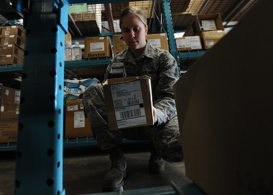 Staff Sgt. Jenna Bruhn, 325th Medical Support Squadron medical materiel technician, scans a box containing medical instruments at the medical materiel facility Jan. 7. The primary mission of the medical materiel technicians and the flight is to synchronize forward logistics and procure medical-surgical supplies to clinicians throughout the 325th MDSS and the entire 325th Medical Group. They serve 28 cost-centers and manage an annual $9.4 million budget.