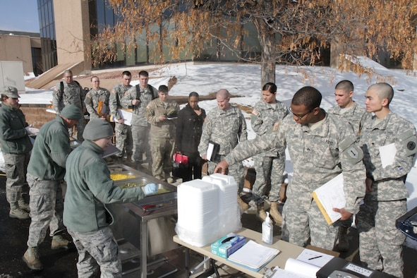 Colorado Guardsmen stand in line to receive lunch prepared in the Disaster Relief Mobile Kitchen Trailer at Joint Force Headquarters in Centennial, Colo., Jan. 9, 2016. The DRMKT was used in support of the simulated state active duty blizzard emergency response exercise. (U.S. Army National Guard Photo by Sgt. Ray Casares)