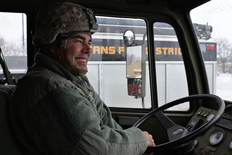 U.S. Army Spc. Bobby J. Morris, a Soldier assigned to the 1st Battalion, 157th Infantry Company B in Fort Lupton, Colo., simulates rescuing stranded people from a local library, transporting them to the Evans Community Complex during a statewide exercise Jan. 8, 2016, in Evans, Colo. (U.S. Air National Guard photo by Senior Airman Bobbie J. Reynolds)